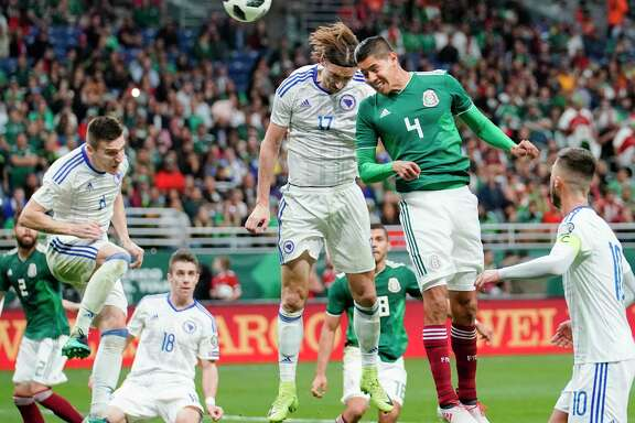 Mexico defender Hugo Ayala (4) beats Bosnia and Herzegovina forward Mersudin Ahmetovic (17) on the head ball for a goal during the second half of an international friendly soccer match Wednesday, Jan. 31, 2018, in San Antonio. Mexico won 1-0. (AP Photo/Darren Abate)