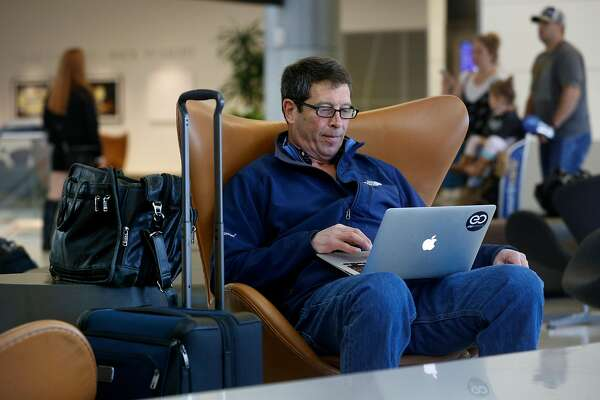 Business traveler Peter Von Der Linda waits for his flight back to New Jersey at San Francisco International Airport on Thursday Feb. 1, 2018, in San Francisco, Calif.