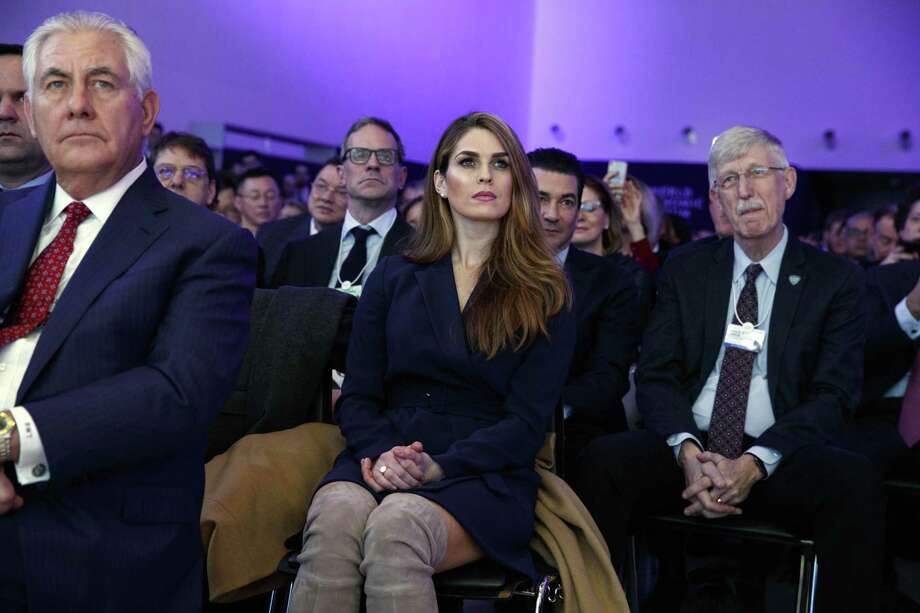 White House Communications Director Hope Hicks, center, and Secretary of State Rex Tillerson, left, listen to President Donald Trump deliver a speech to the World Economic Forum, Friday, Jan. 26, 2018, in Davos. Photo: Evan Vucci / Associated Press / Copyright 2018 The Associated Press. All rights reserved.