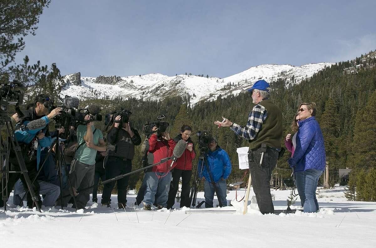 Frank Gehrke, second from right, chief of the California Cooperative Snow Surveys Program for the Department of Water Resources, talks to reporters after conducting the second snow survey of the season Thursday, Feb. 1, 2018, near Echo Summit, Calif. The snow survey showed the snow pack at this location at 13.6 inches of deep with a water content of 2.6 inches. (AP Photo/Rich Pedroncelli)