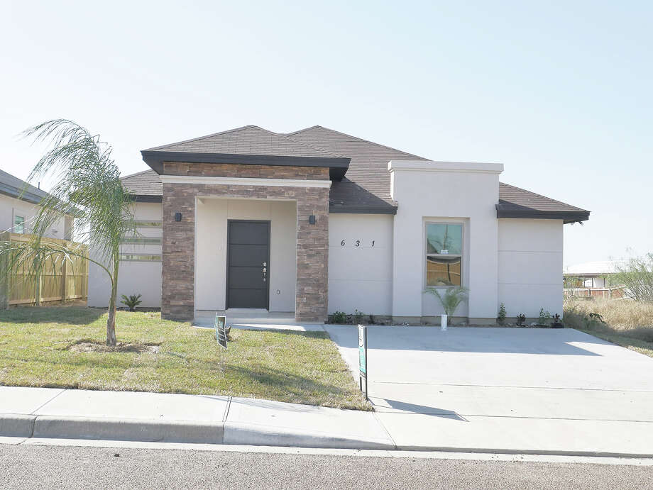 Come and enjoy this gorgeous stucco minimalist contemporary 3 bedroom home with 2 bathrooms.  Over 1350 sq. ft. of living area, all tile floors, granite counter tops in the kitchen with a large breakfast/ island. EXIT REALTY. Flor Gonzalez (956) 324-4445