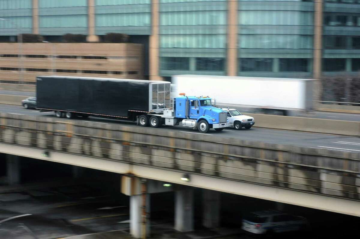 A tractor-trailer drives past Stamford on I-95 north. Gov. Malloy recently halted $4.3 billion worth of transportation projects across the state, including the widening of I-95 between Stamford and Bridgeport.