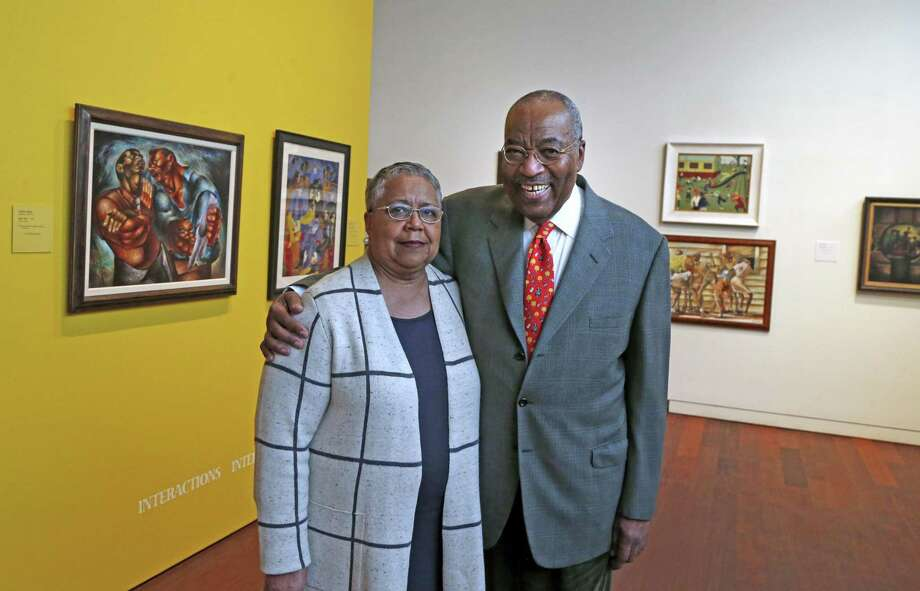 """Dr. Harmon and Harriet Kelley pose inside """"Something to Say: The McNay Presents 100 Years of African American Art,"""" an exhibit at the McNay Art Museum largely drawn from their well-regarded collection. The San Antonio couple began collecting in the 1980s. Photo: Ronald Cortes /For The Express-News / 2017 Ronald Cortes"""