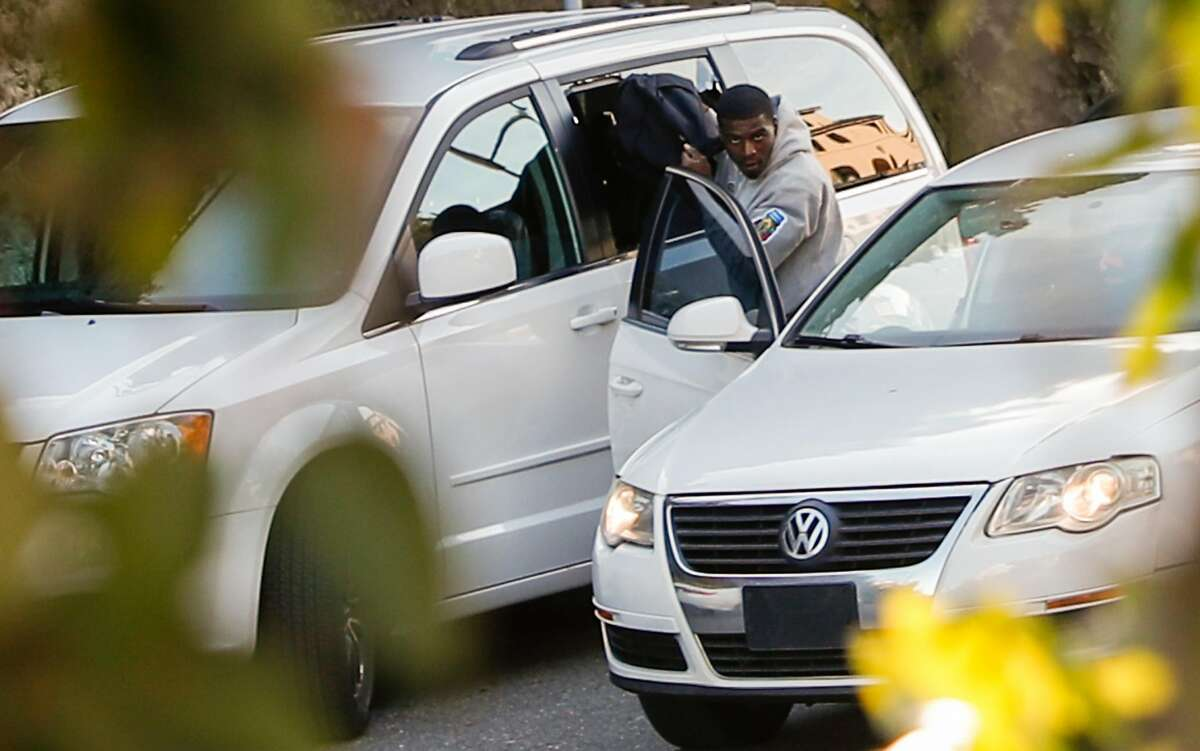 A man, later identified by police as Delon Barker,takes a bag through a broken window of a van parked on Lombard St. on Tuesday, Jan. 30, 2018 in San Francisco. Barker was later arrested after a car chase stemming from an auto burglary investigation in Vacaville.