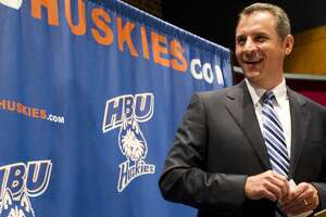 Vic Shealy smiles as he is introduced as the first head football coach at Houston Baptist University Monday, April 9, 2012, in Houston. Shealy,50, comes to HBU from the University of Kansas where he was the defensive coordinator. ( Brett Coomer / Houston Chronicle )