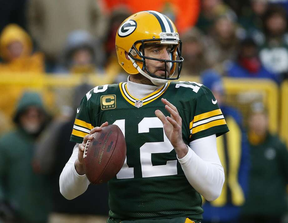 FILE - In this Sunday, Jan. 8, 2017 file photo, Green Bay Packers quarterback Aaron Rodgers (12) looks for a receiver during the first half of an NFC wild-card NFL football game against the New York Giants in Green Bay, Wis.  It's not a coincidence that four superior quarterbacks are the final four left chasing a Super Bowl title. The AP examines a couple of the reasons why Tom Brady, Ben Roethlisberger, Aaron Rodgers and Matt Ryan are as good as they are, and looks at the weakness an opponent should try to exploit, Wednesday, Jan. 18, 2017. (AP Photo/Mike Roemer, File) Photo: Mike Roemer, Associated Press