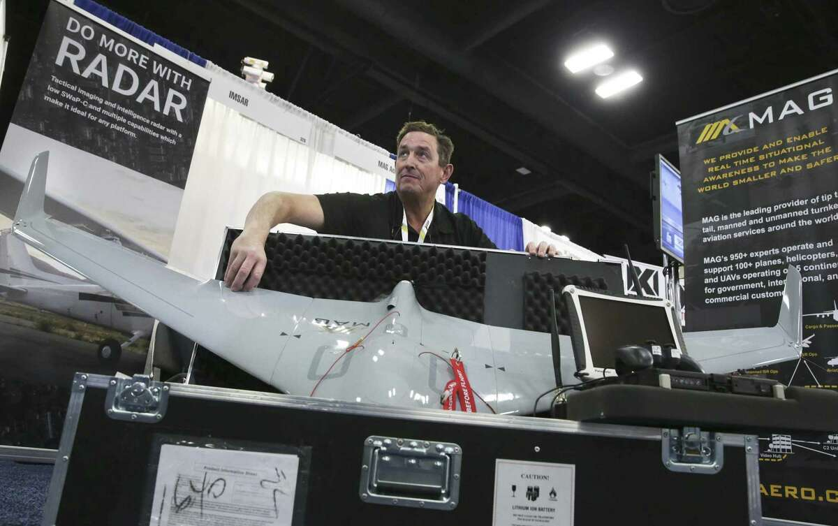 Jim Finell displays Mag Aerospace's stealthy drone which can stay flying for 3 hours during the Border Security Expo at the Henry B. Gonzalez Covention Center on January 31, 2018.