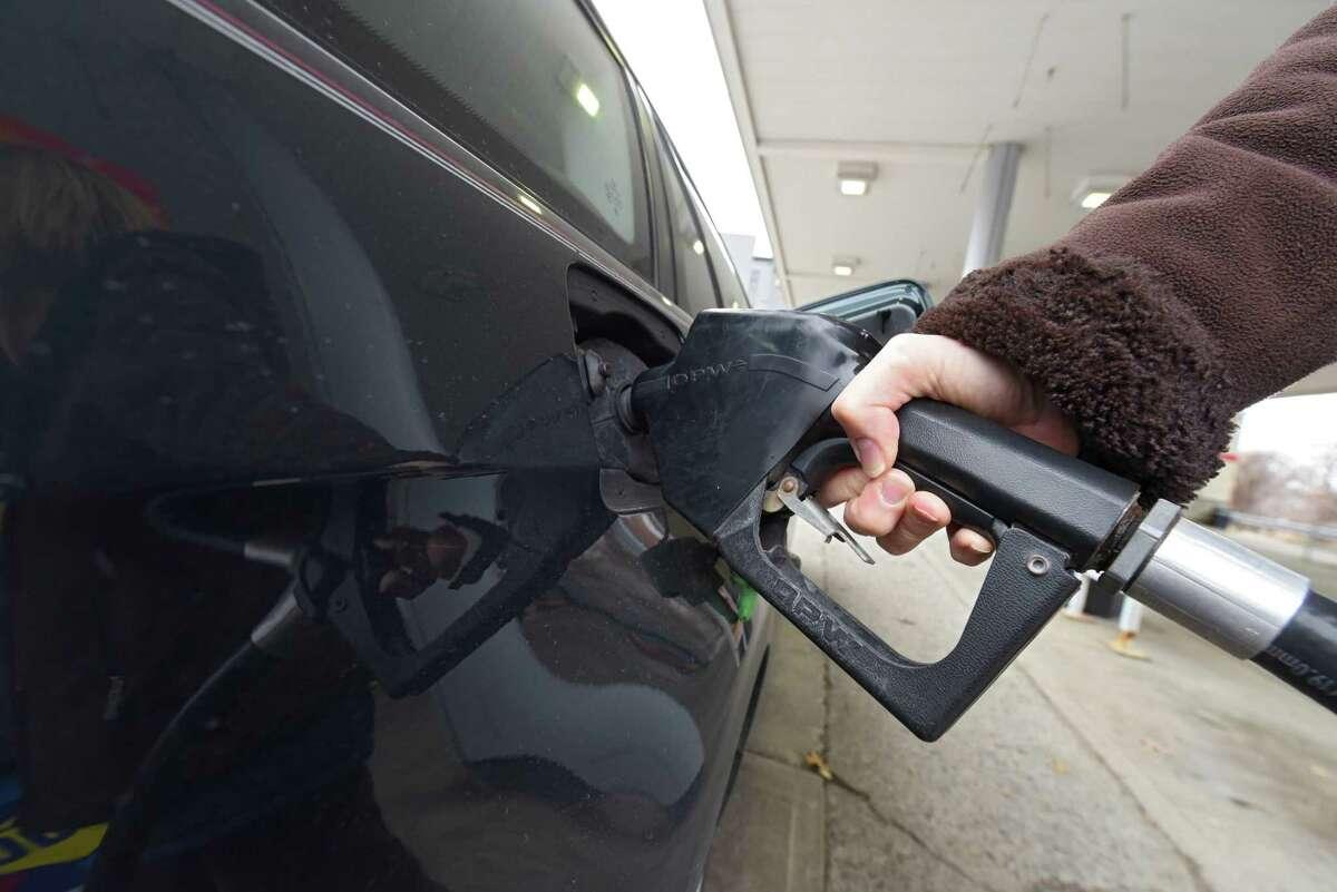 Cathy Lott of Bethlehem pumps gas at a Sunoco gas station on Thursday, Feb. 1, 2018 in Albany, N.Y. (Lori Van Buren/Times Union)