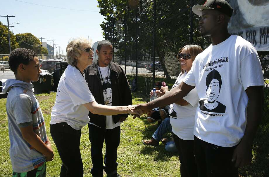 Dolores Piper greets Jeff Stewart, a close friend of Mario Woods, during last summer's 2nd Annual Mario Woods Remembrance Day. Photo: Leah Millis, The Chronicle