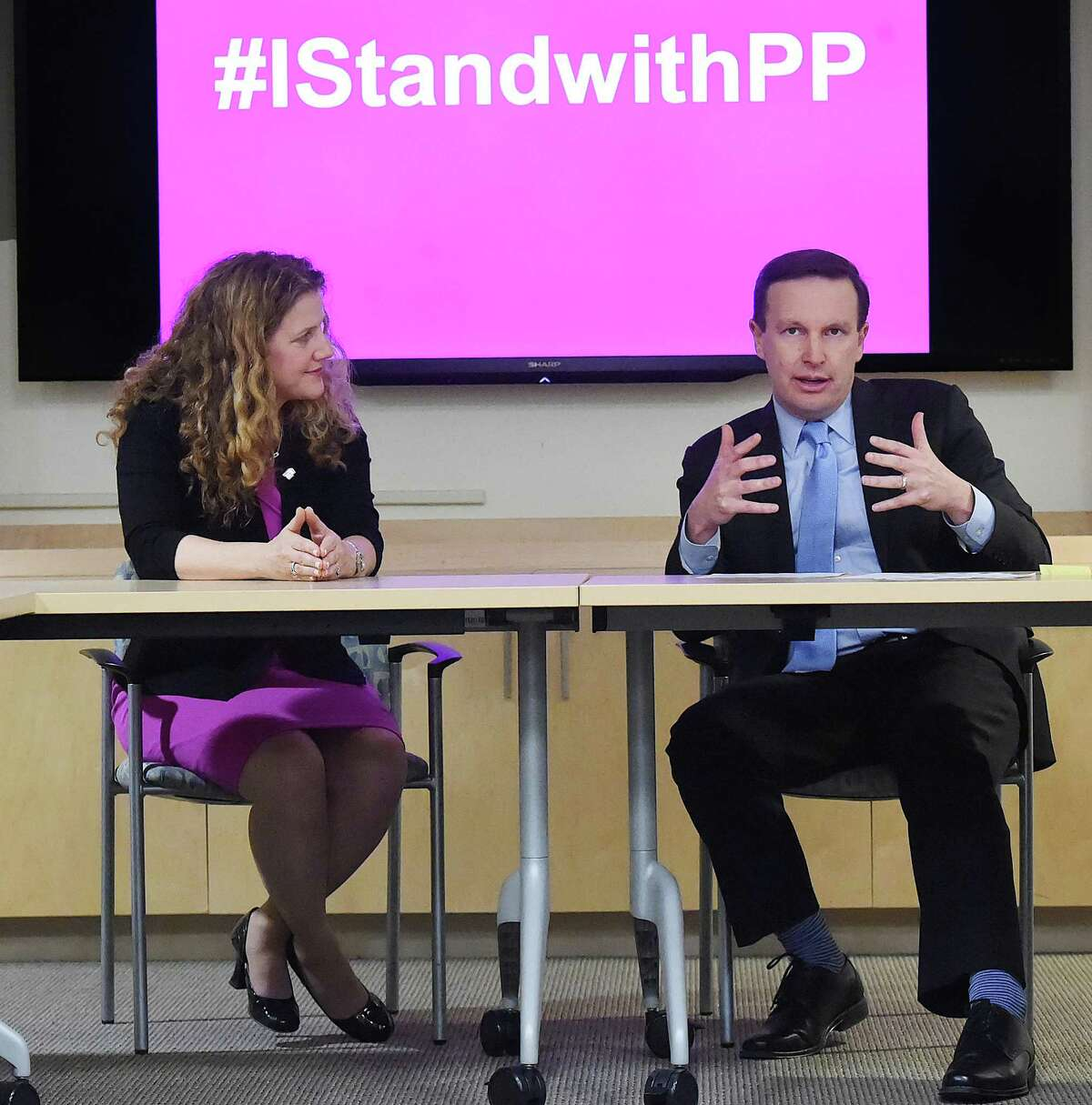 Amanda Skinner, president and CEO of Planned Parenthood of Southern New England, listens to U.S. Sen. Chris Murphy speak at a roundtable discussion Thursday in New Haven.