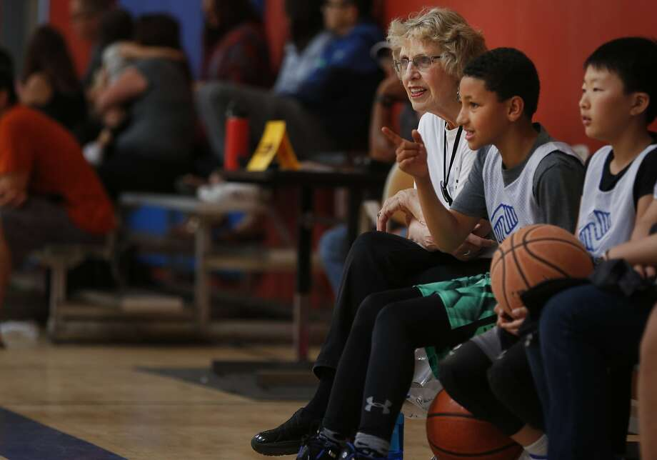 Dolores Piper and her great-nephew, Michael Red, sit on the sidelines before one of his basketball games. Photo: Leah Millis, The Chronicle