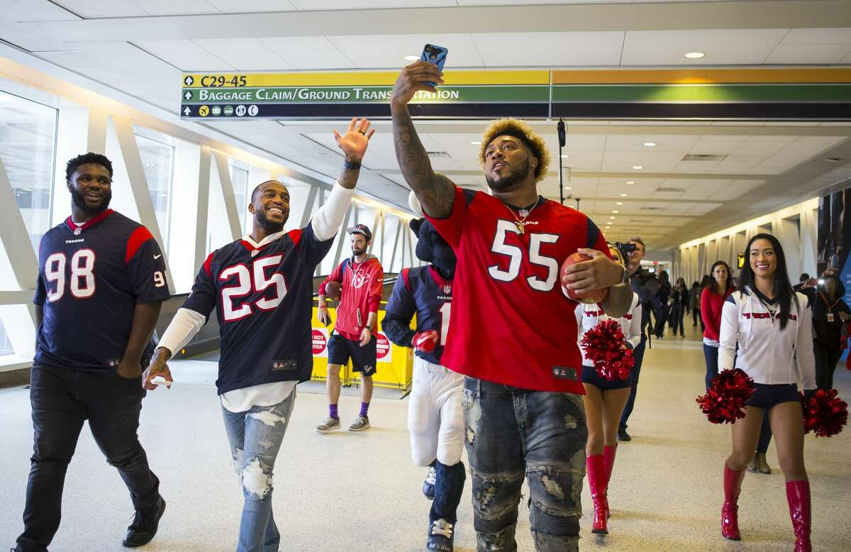 Houston Texans players DJ Reader (98), Kareem Jackson (25) and Benardrick McKinney (55) walk through Terminal C to visit a United flight to Chicago O'Hare from George Bush Intercontinental Airport, Thursday, Feb. 1, 2018, in Houston. ( Mark Mulligan / Houston Chronicle )