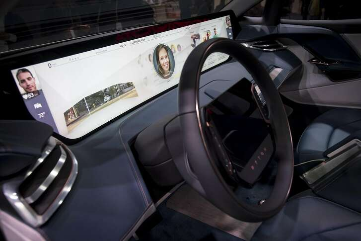 The Byton electric concept vehicle interior is displayed during the 2018 Consumer Electronics Show (CES) in Las Vegas, Nevada, U.S., on Wednesday, Jan. 10, 2018. Electric and driverless cars will remain a big part of this year's CES, as makers of high-tech cameras, batteries, and AI software vie to climb into automakers' dashboards. Photographer: David Paul Morris/Bloomberg