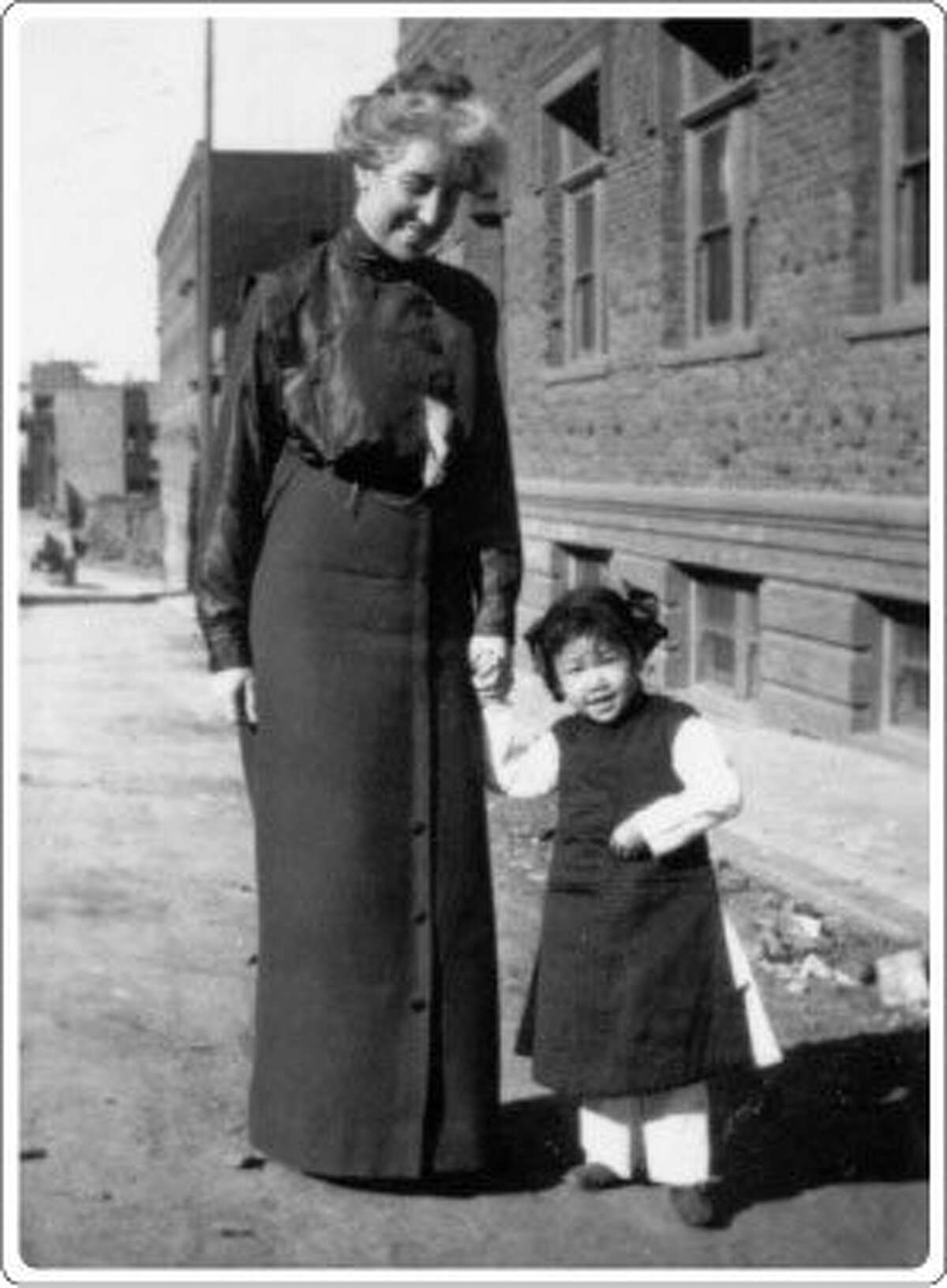 This undated photo shows Donadina Cameron and an unnamed girl. Cameron joined the Occidental Home when she was 25 years old and soon became the superintendent.