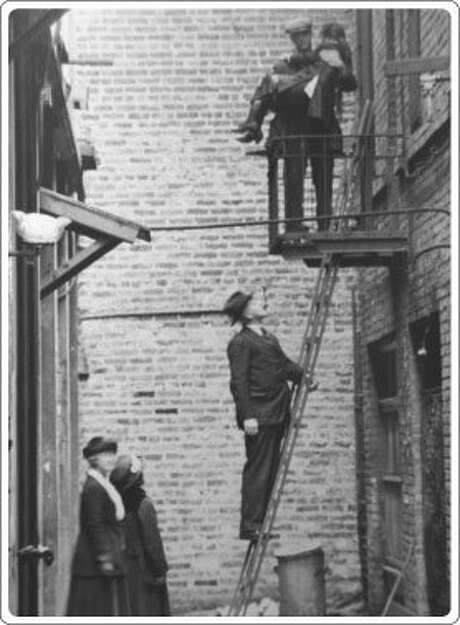 This undated photo shows Donaldina Cameron (pictured below) during a rescue in Chinatown. Photo: Courtesy Of The Cameron House Archives