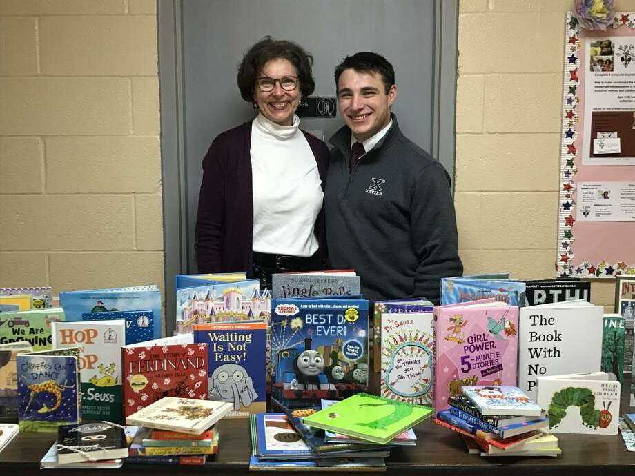 Xavier High School student Jordan Leonardi coordinated a book collection which yielded 80 new books during the December holidays. His self-driven project's goal was to promote education in young children. Photo: Contributed Photo /