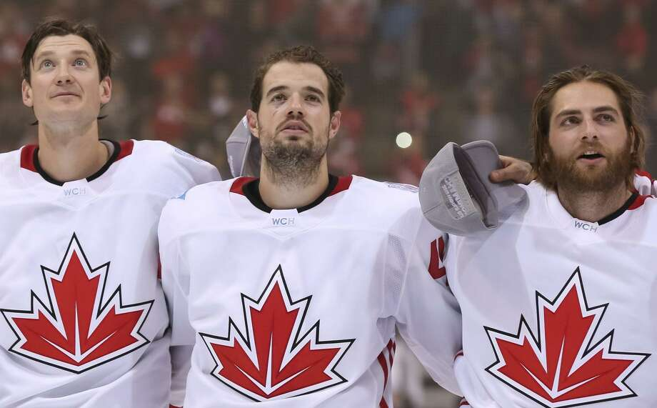 Jay Bouwmeester #4, Marc-Edouard Vlasic #44 and Braden Holtby #70 of Team Canada sing their national anthem during Game Two of the World Cup of Hockey final series at the Air Canada Centre on September 29, 2016 in Toronto, Ontario, Canada. Photo: Andre Ringuette / World Cup Of Hockey Via Getty Images / 2016 World Cup of Hockey