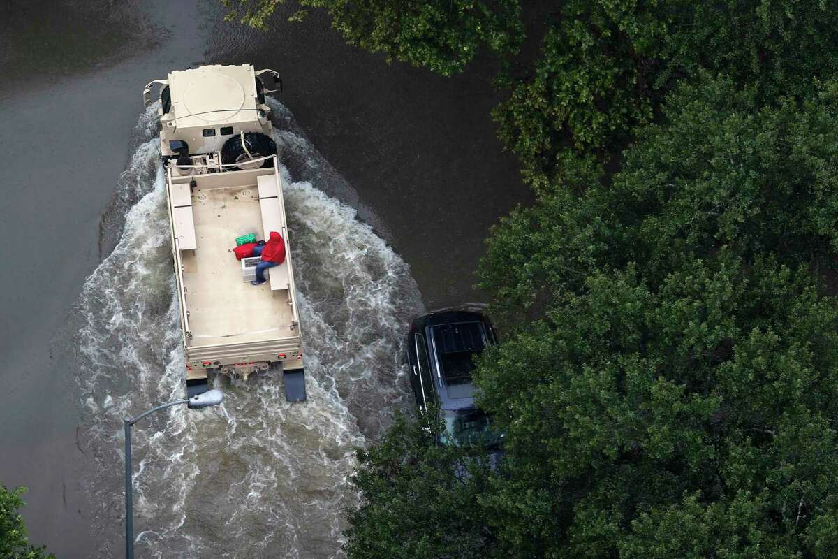 A rescue vehicle drives through a neighborhood off Cypress Creek in Houston as floodwaters rise from Hurricane Harvey on Aug. 29, 2017. Brett Coomer / Houston Chronicle )