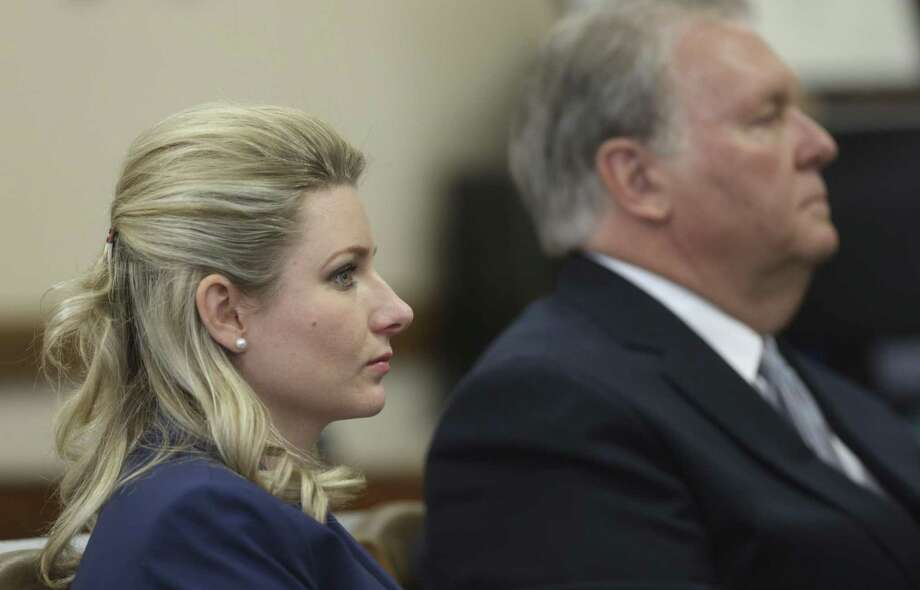 "Kristin Tips and her husband, Robert ""Dick"" Tips, attend the trial in a lawsuit in which they are accused by the parents of Julie Mott of gross negligence. Mott's body disappeared from a casket at Mission Park Funeral Chapels North, run by the Tipses' company. Photo: William Luther / San Antonio Express-News / © 2018 San Antonio Express-News"
