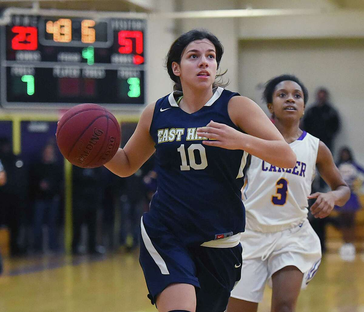 East Haven's Olivia Coyle drives past Career's Nicole Washington, Thursday, Feb. 1, 2018, at the Career High School gymnasium in New Haven. East Haven won, 59-25.