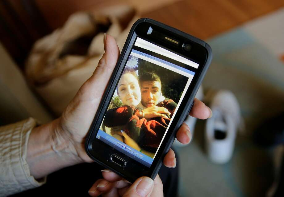 Dolores Piper displays a photo in July of her nephew Derrick Gaines with his girlfriend, Elizabeth Avalos. It was recovered from a cell phone belonging to Gaines, who was shot and killed by police in 2012 in South San Francisco. Photo: Michael Macor, The Chronicle