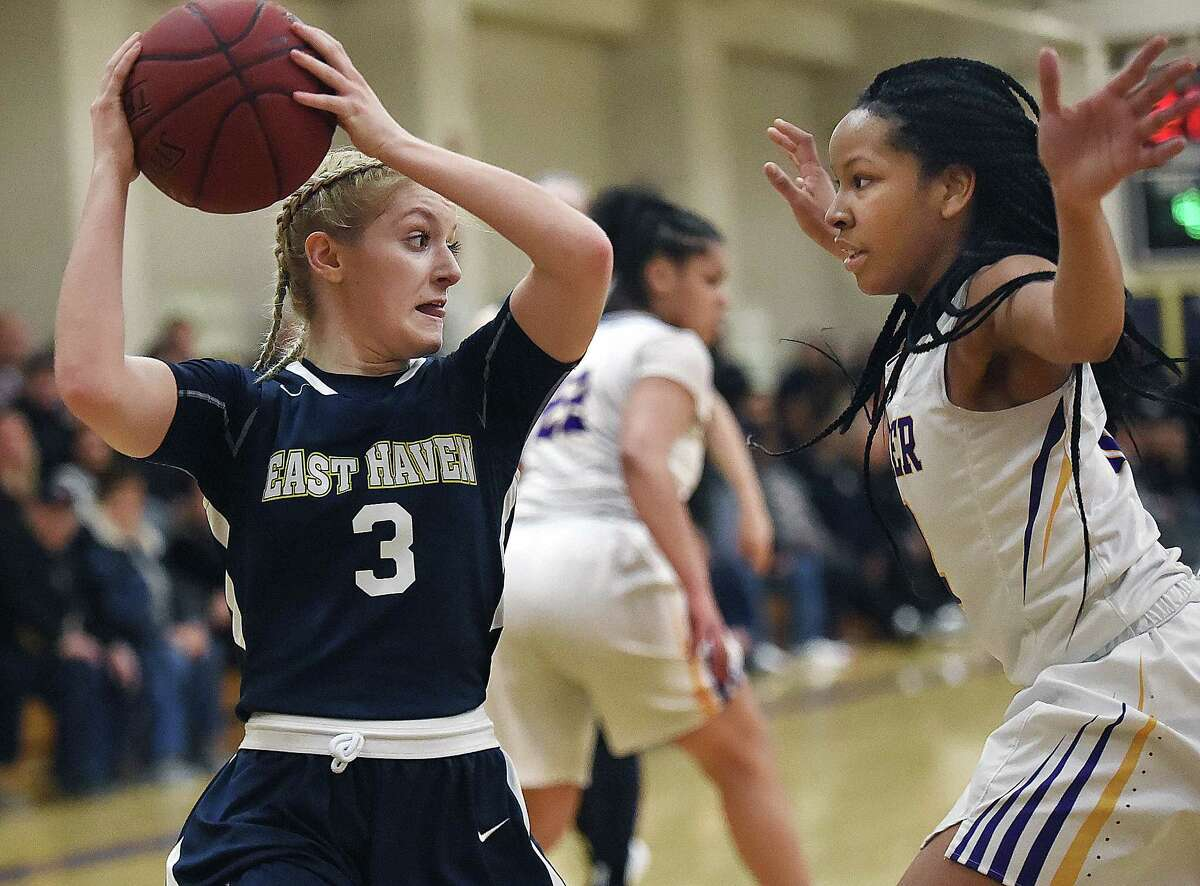 East Haven's Makenzie Helms looks to make a pass as Career's Ciara Little defends, Thursday, Feb. 1, 2018, at the Career High School gymnasium in New Haven. East Haven won, 59-25.