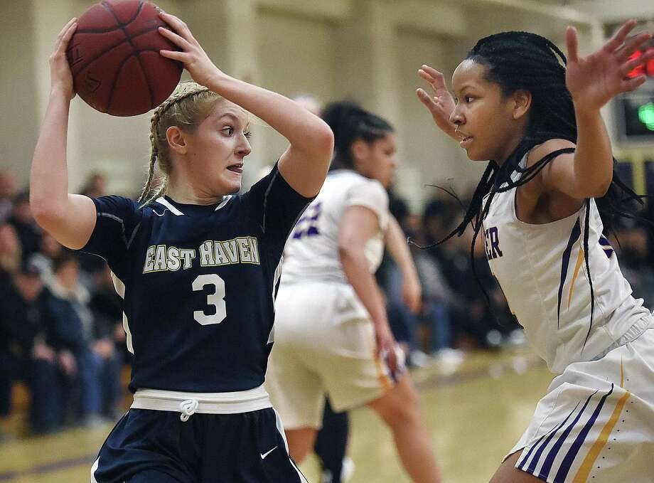 East Haven's Makenzie Helms looks to make a pass as Career's Ciara Little defends, Thursday, Feb. 1, 2018, at the Career High School gymnasium in New Haven. East Haven won, 59-25. Photo: Catherine Avalone, Hearst Connecticut Media / New Haven Register