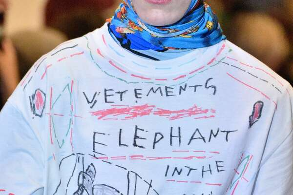 SAINT-OUEN, FRANCE - JANUARY 19:  A model, fashion detail, walks the runway during the Vetements Menswear Fall/Winter 2018-2019 show as part of Paris Fashion Week on January 19, 2018 in Saint-Ouen, France.  (Photo by Peter White/Getty Images)