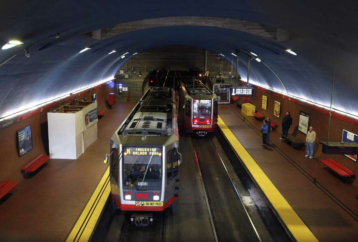 Muni Metro trains arrive and depart at West Portal Station in San Francisco. The Twin Peaks tunnel celebrates its 100th anniversary Saturday.