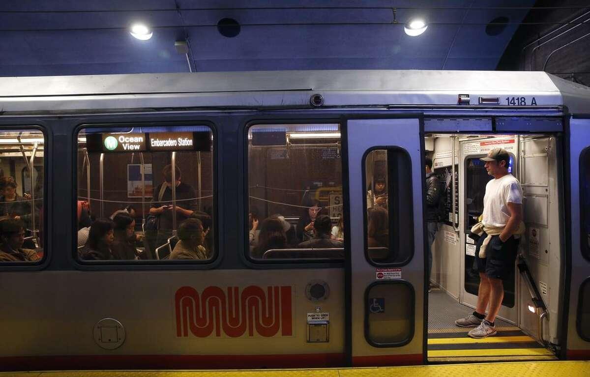 Commuters wait for an inbound M-Ocean View train to depart West Portal Station.