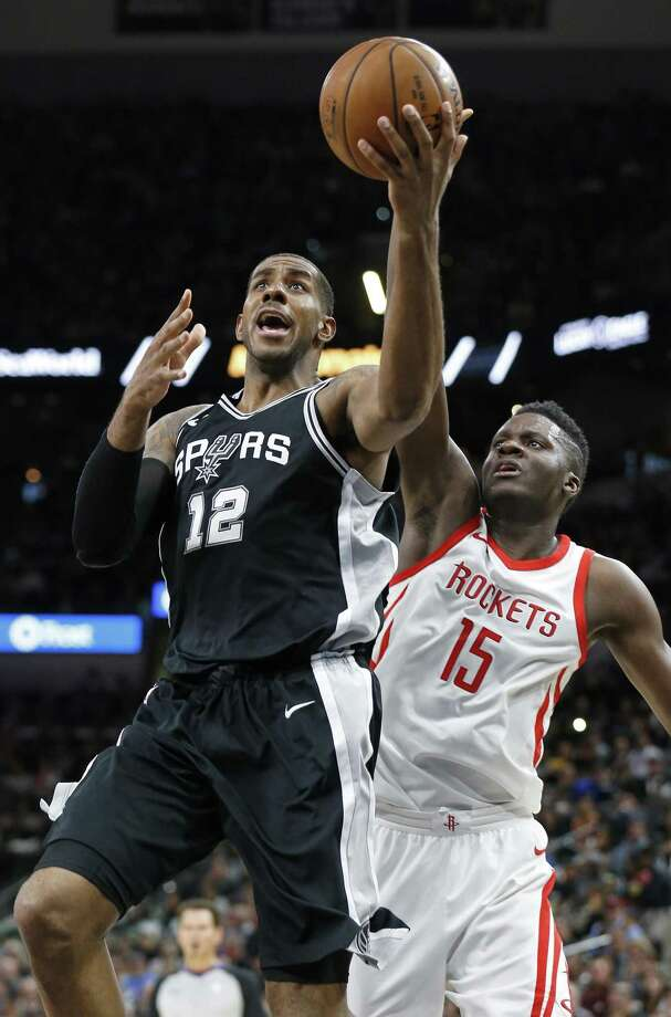 San Antonio Spurs' LaMarcus Aldridge shoots around Houston RocketsÕ Clint Capela during first half action Thursday Feb. 1, 2018 at the AT&T Center. Photo: Edward A. Ornelas, Staff / San Antonio Express-News / © 2018 San Antonio Express-News