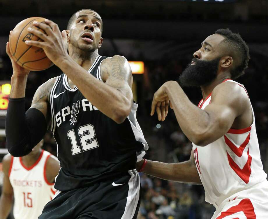 San Antonio Spurs' LaMarcus Aldridge looks for room around Houston RocketsÕ James Harden during first half action Thursday Feb. 1, 2018 at the AT&T Center. Photo: Edward A. Ornelas,  Staff / San Antonio Express-News / © 2018 San Antonio Express-News
