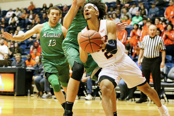 UTSA's Jhivvan Jackson (right) drives under Marshall'sAdjin Penava on his way to the basket during the first half of their men's basketball game at the Convocation Center on Thursday, Feb. 1, 2018.  MARVIN PFEIFFER/mpfeiffer@express-news.net