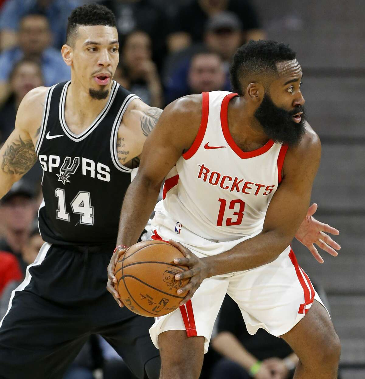 San Antonio Spurs' Danny Green defends Houston Rockets?• James Harden during first half action Thursday Feb. 1, 2018 at the AT&T Center.