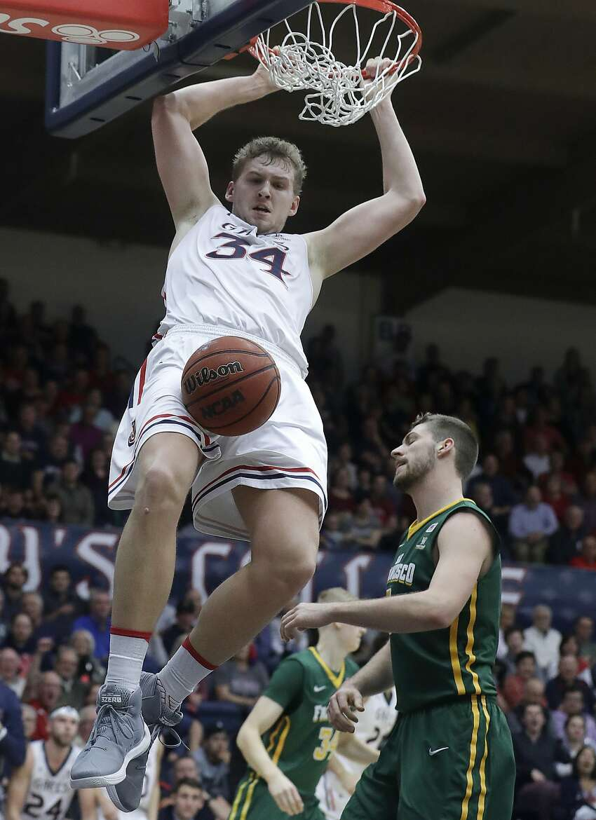 Saint Mary's (Cal.) center Jock Landale (34) dunks over San Francisco center Jimbo Lull (5) during the second half of an NCAA college basketball game in Moraga, Calif., Thursday, Feb. 1, 2018. (AP Photo/Jeff Chiu)