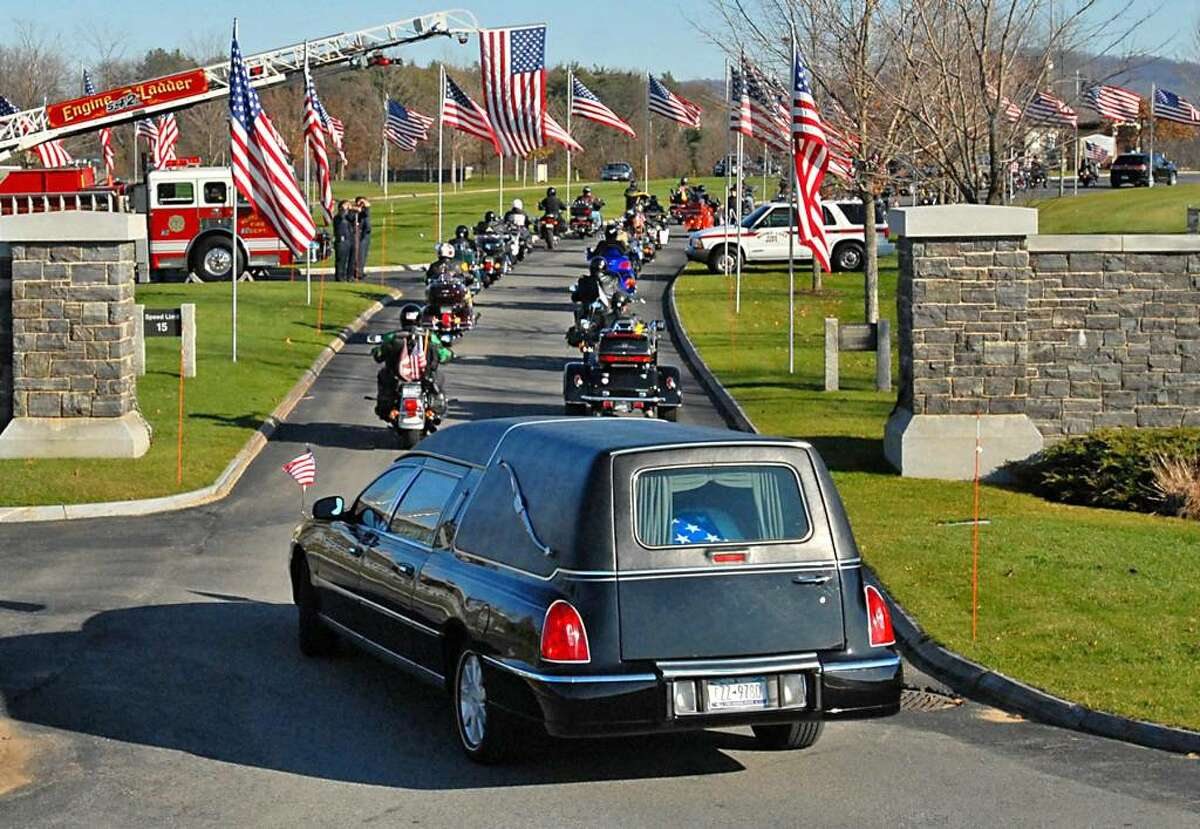 The funeral procession for Staff Sgt. Amy Seyboth Tirador, who died in Iraq, enters Gerald B.H. Solomon Saratoga National Cemetery in Schuylerville on Nov. 17. (Lori Van Buren/Times Union)