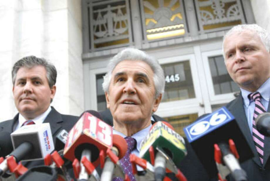 Joseph Bruno, center, flanked by son Kenneth Bruno, left, and Chris Thompson, right, speaks to the media after a day of jury deliberations on Friday, Dec. 4, 2009, at the federal courthouse in Albany, N.Y. (Cindy Schultz / Times Union)