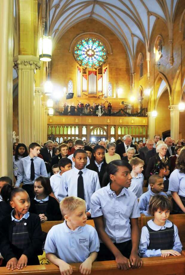 Blessed Sacrament students listen to Bishop Howard Hubbard celebrate Christmas Mass on Friday at Blessed Sacrament Catholic Church in Albany. (John Carl D'Annibale/Times Union) Photo: John Carl D'Annibale / 00006702A