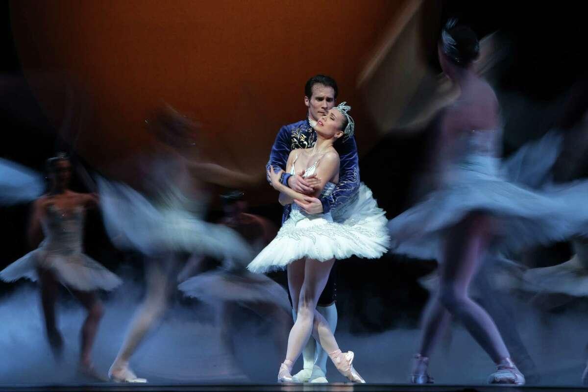 """Principle dancers Seth Orza, as Prince Siegfried, and Noelani Pantastico, as Odette/Odile, perform with the Pacific Northwest Ballet company during a final dress rehearsal of """"Swan Lake"""" at McCaw Hall in Seattle, Thursday, Feb. 1, 2018, on the eve of opening night. The show is choreographed by PNB's Founding Artistic Director Kent Stowell and includes scenery designed by Ming Cho Lee and bold costumes designed by """"Hamilton"""" costume designer Paul Tazewell."""