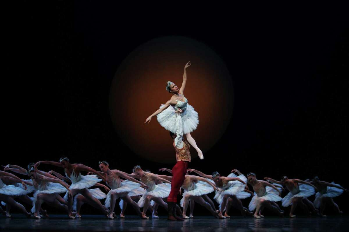 Lead dancers Seth Orza, as Prince Siegfried, and Noelani Pantastico, as Odette/Odile, perform with the Pacific Northwest Ballet company during a final dress rehearsal.