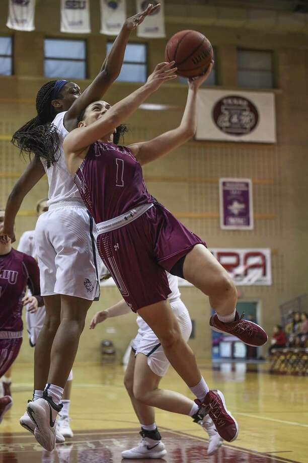 TAMIU junior guard Tantashea Giger has two straight double-doubles as the Dustdevils head to St. Edward's and St. Mary's this week looking to avoid two losses that would claim the worst season in school history and tie the program's longest losing streak. Photo: Danny Zaragoza /Laredo Morning Times File