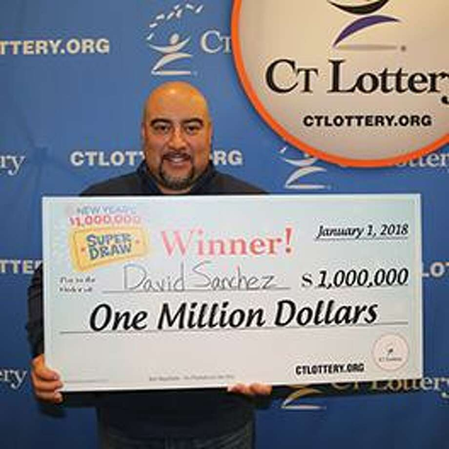 David Sanchez holding his $1,000,000 check after cashing in his winning CT Lottery ticket. Photo: CT Lottery Photo