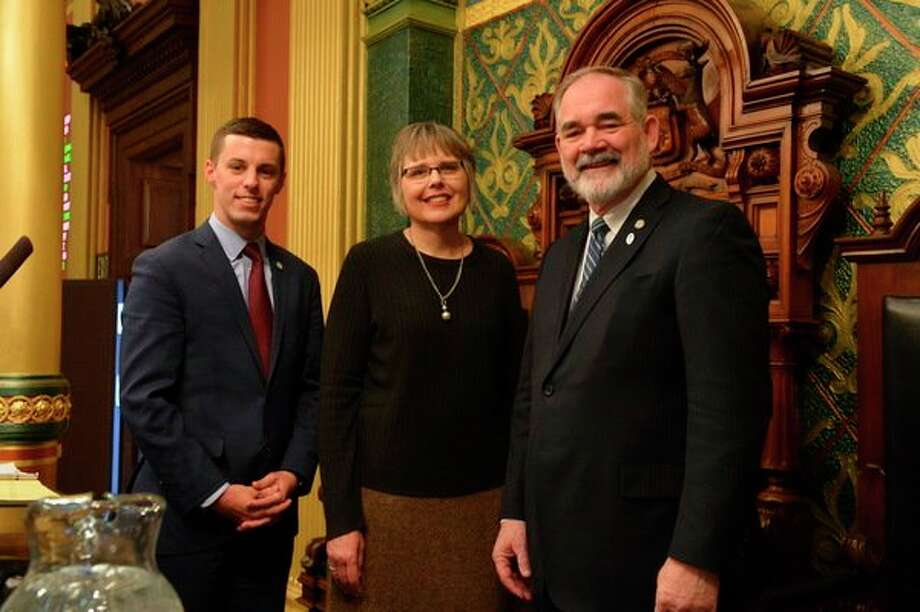 State Rep. Edward J. Canfield (right) recently welcomed Pastor Karen Wolfe of Colling Church of the Nazarene in Unionville to deliver the invocation before the Michigan House of Representatives. Canfield and Wolfe were joined at the rostrum by Speaker Pro Tempore Lee Chatfield. House tradition calls for a representative or clergy member to begin each day's session with a prayer. (Submitted Photo)
