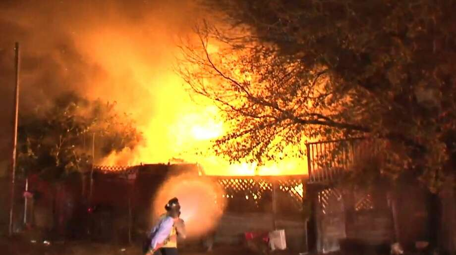 A fire destroyed a north Houston home where several families were living.