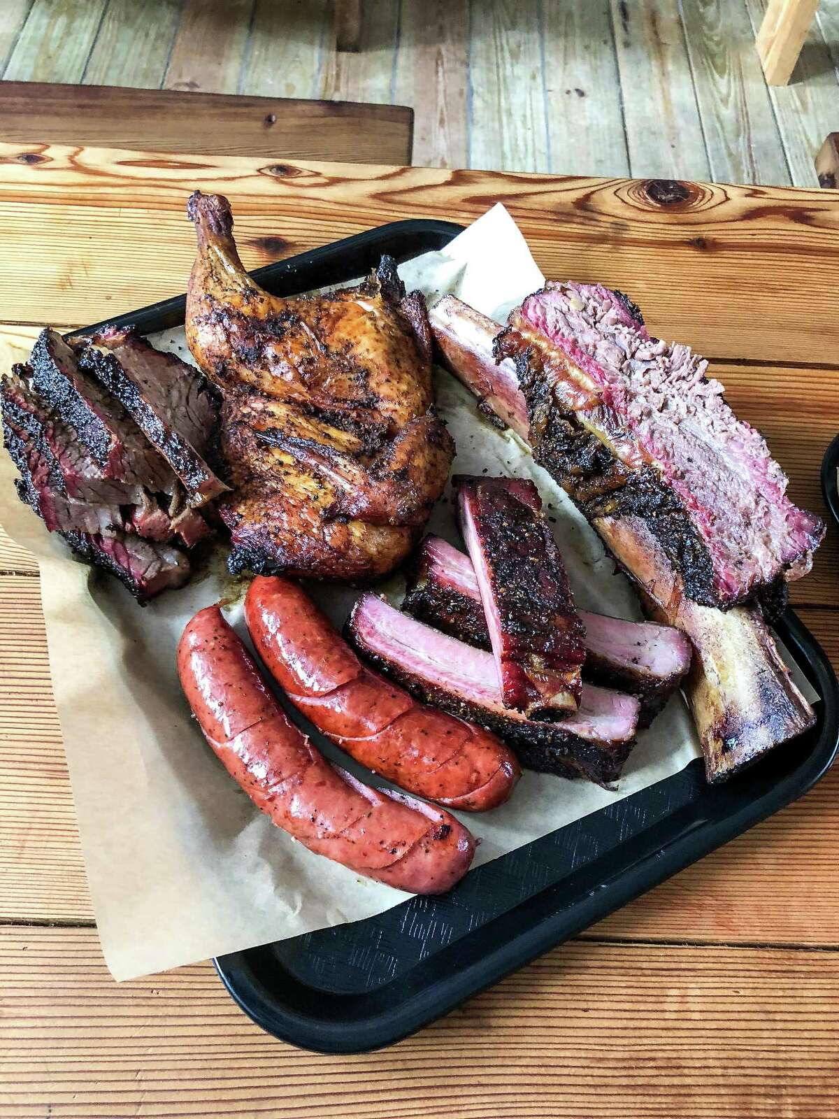 """The """"trinity"""" of brisket, pork ribs and sausage Malekian makes by hand, along with chicken and beef ribs, are on the menu."""