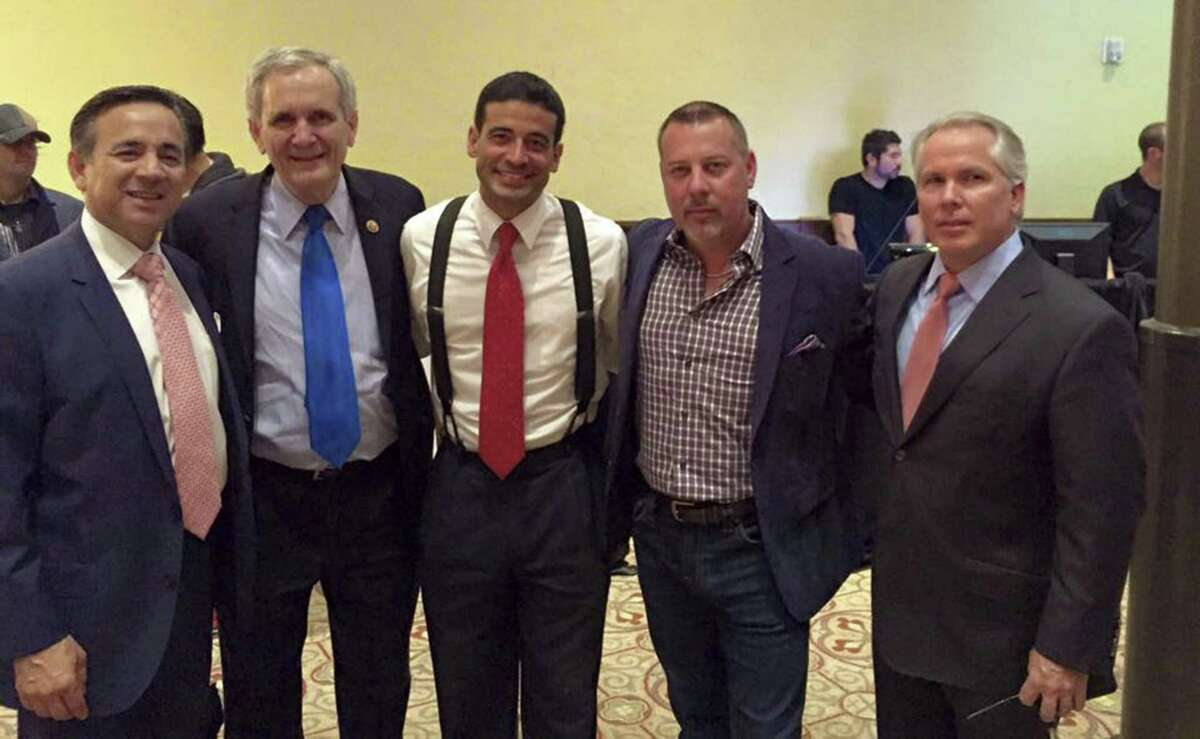Jurors in the criminal case of Carlos Uresti and Gary Cain were shown a 2014 photo from FourWinds Logistics CEO Stan Bates' Facebook page. Pictured left to right are now-ex state Sen. Uresti, Congressman Lloyd Doggett, current Bexar County District Attorney Nico LaHood, Bates and attorney Thomas J. Henry.
