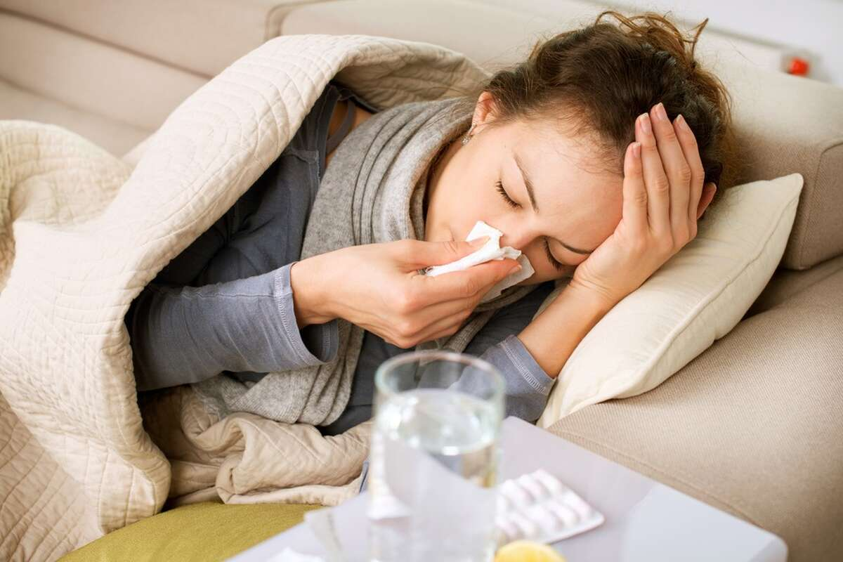Have a cough? Stuffy nose? Body aches? Feverish? If you are experiencing at least two flu-like symptoms, Seattle Flu Study researchers want to swab your nose to track how the virus is spread around the city. Keep clicking for photos of how different American cities faced the 1918 flu pandemic...