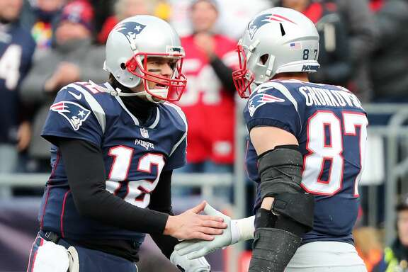 FOXBORO, MA - DECEMBER 24:  Rob Gronkowski #87 of the New England Patriots reacts with Tom Brady #12 after catching a touchdown pass during the second quarter of a game against the Buffalo Bills at Gillette Stadium on December 24, 2017 in Foxboro, Massachusetts.  (Photo by Adam Glanzman/Getty Images)