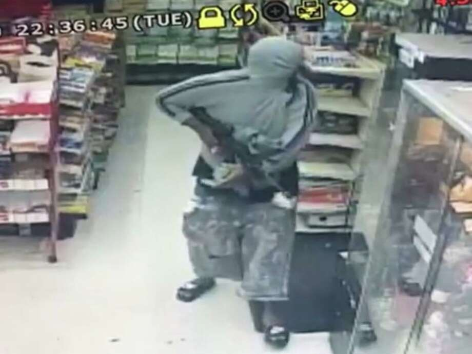 A still frame from a surveillance camera that captured an armed suspect inside a Fourth Street gas station on Tuesday night.
