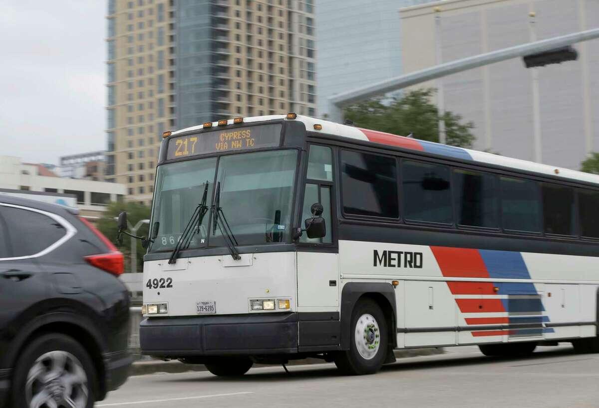 A bus moves along Louisiana near Franklin Friday, Jan. 26, 2018, in Houston.
